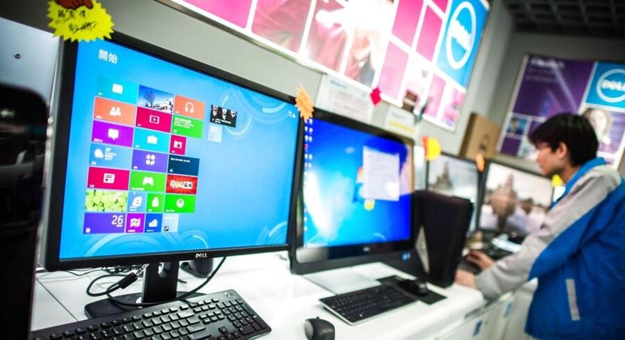 Windows 8 er blevet forbudt på mange computere, som myndighederne i Kina bruger. Det har sat skub i udviklingen af endnu et kinesisk alternativt styresystem, som bliver klar til oktober. Arkivfoto: Philippe Lopez, AFP/Scanpix