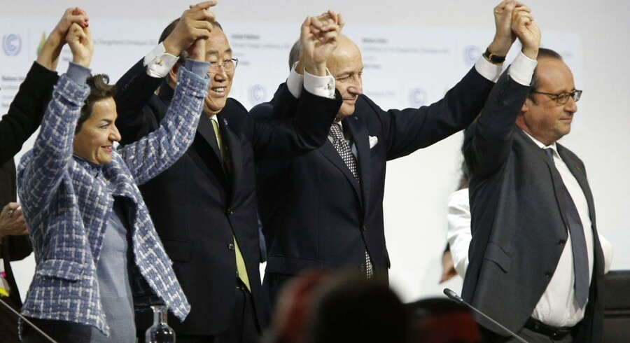 (FILES) This file picture taken on December 12, 2015 shows Foreign Affairs Minister and President-designate of COP21 Laurent Fabius (2R), raising his hands with Secretary General of the United Nations Ban Ki Moon (2L) and France's President Francois Hollande (R) after the adoption of a historic global warming pact at the COP21 Climate Conference in Le Bourget, north of Paris. Eight months after its adoption by 195 countries, the Paris agreement in the fight against global warming has been described as historic. However, an entry into force by the end of 2016 is considered possible but unlikely before COP22 in Marrakech in November. / AFP PHOTO / FRANCOIS GUILLOT