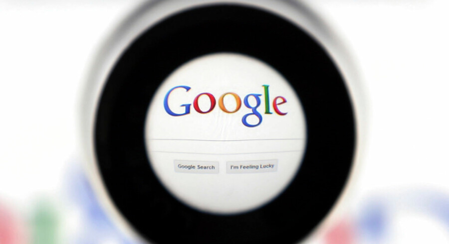 A Google search page is seen through a magnifying glass in this photo illustration taken in Brussels May 30, 2014. Google has taken the first steps to meet a European ruling that citizens can have objectionable links removed from Internet search results, a ruling that pleased privacy campaigners but raised fears that the right can be abused to hide negative information. REUTERS/Francois Lenoir (BELGIUM - Tags: SCIENCE TECHNOLOGY POLITICS)