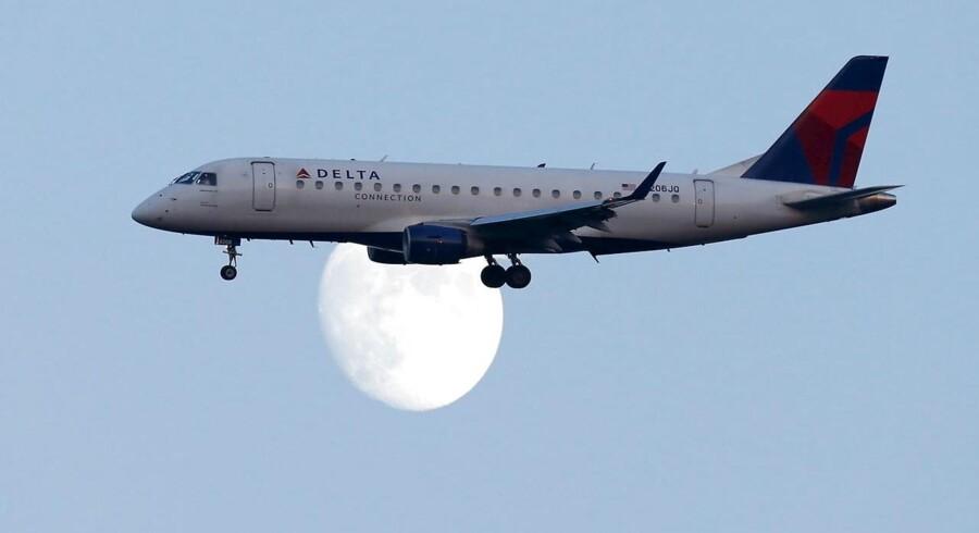 Flere kunder skal nu flyttes fra et fly som dette over i meget mindre privatfly, hvis det står til flyselskabet Delta Airlines.