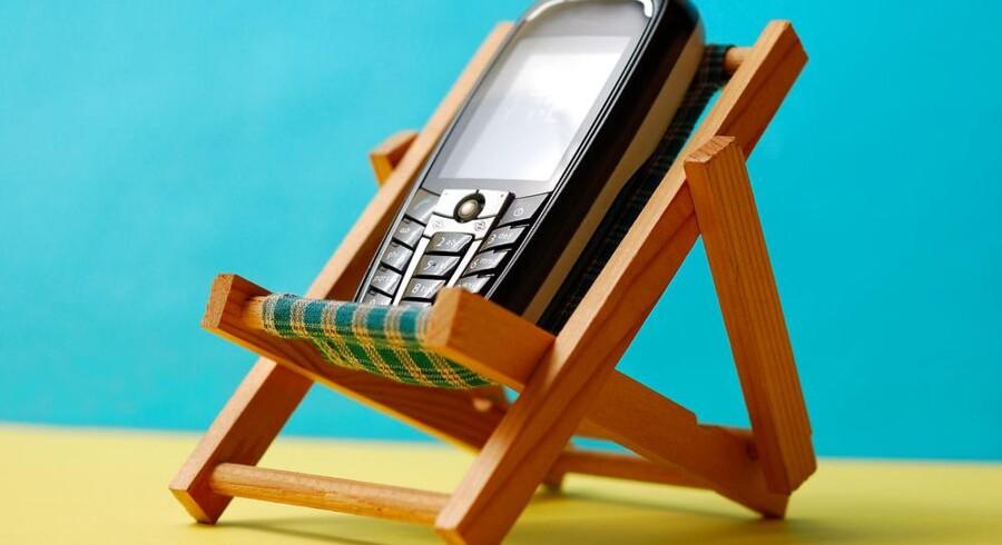 Sommerferien bliver billigere for dem, der planlægger at bruge mobiltelefonen eller computeren i udlandet. Foto: Iris/Scanpix