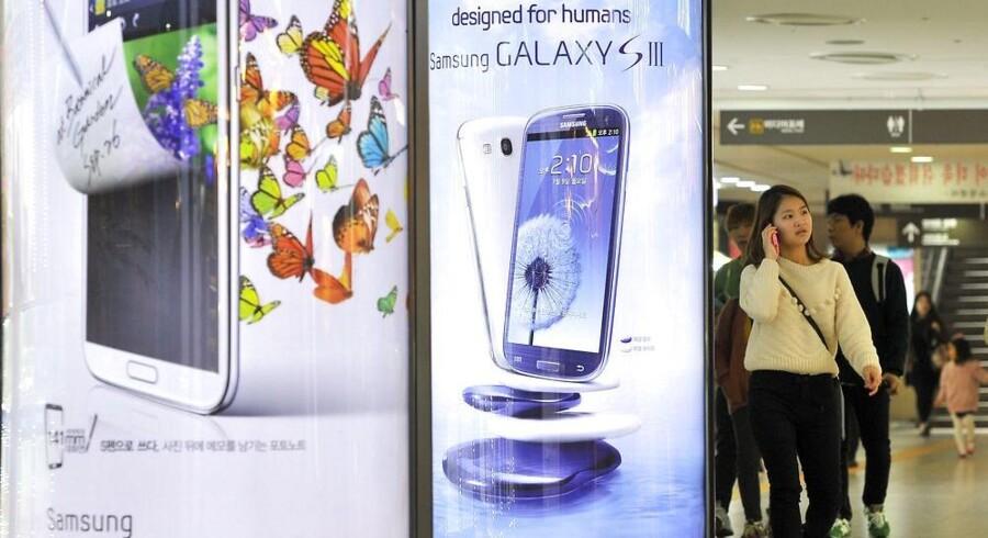 Galaxy S III-telefonen er Samsungs topmodel og en storsællert. Foto: Jung Yeon-Je, AFP/Scanpix