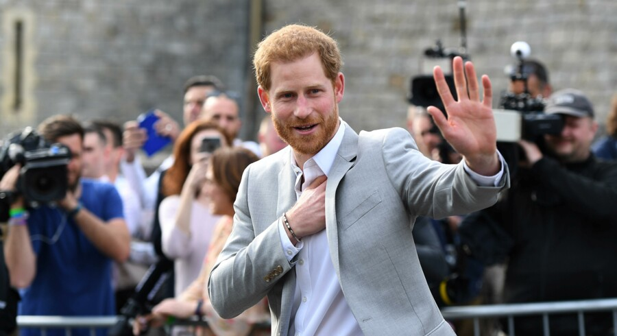 Britain's Prince Harry greets wellwishers outside Windsor Castle ahead of his wedding to Meghan Markle tomorrow, in Windsor, Britain, May 18, 2018. REUTERS/Clodagh Kilcoyne
