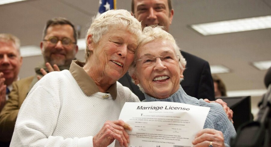 SEATTLE, WA - DECEMBER 6: Jane Abbott Lighty, left, and Pete-e Petersen embrace after receiving the first same-sex marriage license in Washington state at the King County Recorder's Office on December 6, 2012 in Seattle, Washington. The office opened at 12:01 AM PST to begin issuing marriage licenses to same-sex couples for the first time after Washington voters chose to legalize same-sex marriage in November's election. David Ryder/Getty Images/AFP == FOR NEWSPAPERS, INTERNET, TELCOS & TELEVISION USE ONLY ==