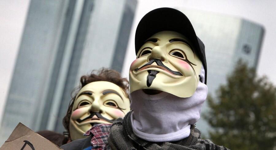 Anonymous er blandt andet kendt for deres masker, der forestiller den katolske forkæmper Guy Fawkes. Her er det dog Occupy Wall Street-bevægelsen , der bruger masken.