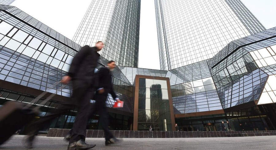epa05115537 Two men walk past a Deutsche Bank headquarters in Frankfurt am Main, Germany, 21 January 2016. Deutsche Bank, Germany's largest lender, will likely report a net loss of about 6.7 billion euros (7.3 billion dollars) for 2015, largely due to restructuring charges and money set aside to cover legal costs. Full-year revenue for 2015 will likely be around 33.5 billion euros, the bank said in a statement 20 January 2016. EPA/ARNE DEDERT