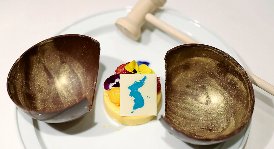 "This undated picture released by the South Korean presidential Blue House on April 24, 2018 shows a mango mousse cake decorated with a garnish in the shape of a unified Korean peninsula, which will be served at the dinner of the upcoming inter-Korean summit. The cake is in a wooden bowl, a symbol of Cold War confrontation, which will be broken by a hammer to symbolize the start of reconciliation. Symbolism will be the main course of a banquet at the upcoming inter-Korean summit, Seoul revealed on April 24, with a menu featuring Pyongyang's signature dish and food from the home towns of the South's leaders at previous meetings. / AFP PHOTO / The Blue House AND AFP PHOTO / handout / RESTRICTED TO EDITORIAL USE - MANDATORY CREDIT ""AFP PHOTO / THE BLUE HOUSE"" - NO MARKETING NO ADVERTISING CAMPAIGNS - DISTRIBUTED AS A SERVICE TO CLIENTS"