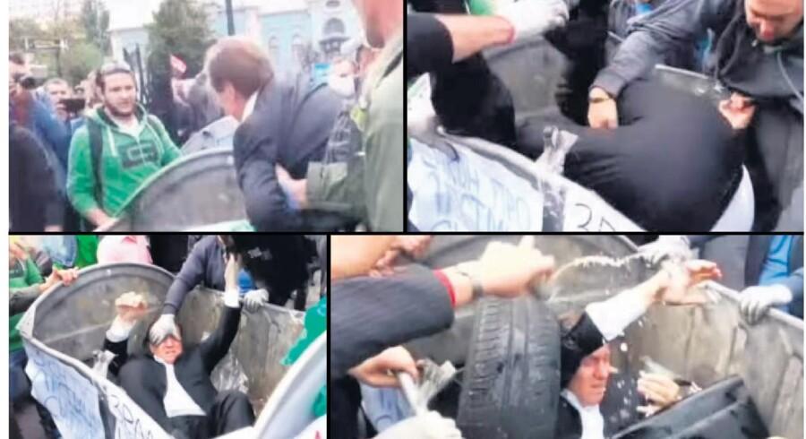 Vitaly Zhuravsky, ukrainsk parlamentsmedlem og tidligere minister under Janukovitj, blev i september ramt af den selvtægtsbølge, som i den seneste tid har sendt snesevis af korruptionsanklagede politikere og embedsmænd ned i til lejligheden opstillede affaldsbeholdere med hovedet forrest. Metoden er blevet et viralt fænomen på de sociale medier. Billederne stammer således også fra en YouTube-video.