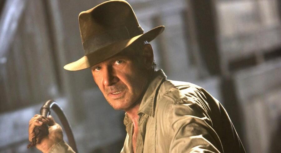 »Når Indiana Jones i Spielbergs »Jagten på den forsvundne skat« strides med skurke om arkæologiske skatte, er det helt unødvendigt for spændingen at vide noget om de skatte, striden står om. » Harrison Ford som Indiana Jones. Arkivfoto: Scanpix
