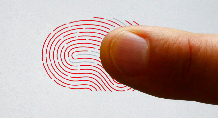A person uses a sensor for biometric identification on a smartphone in Berlin, Germany October 16, 2015. On the verge of collapse a decade ago, Sweden's Fingerprint Cards (FPC) has emerged market leader in a booming industry set to supply billions of touch fingerprint sensors for smartphones, tablets and credit cards in the years ahead. After years in the wildnerness, plowing cash into product development, the main rival of U.S. Synaptics has seen demand soar in 2015, bagging deals from some of China's biggest smartphone makers and U.S. tech giant Google. REUTERS/Fabrizio Bensch