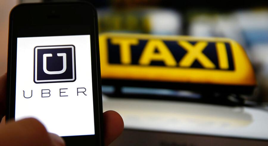 ARKIVFOTO 2014 af Uber taxi app- - Se RB 19/11 2014 07.10. Taxibranchen frygter ikke konkurrence fra det nye koncept Uber, hvis det foregår på lovlig vis. (Foto: KAI PFAFFENBACH/Scanpix 2014)