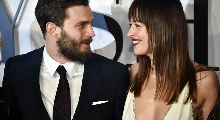 Skuespillerne, der medvirker i 'Fifty Shades of Grey'-filmen Jamie Dornan og Dakota Johnson ankommer til den engelske premiere den 12. februar 2015.