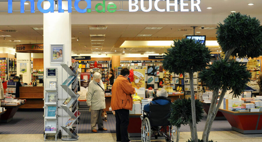 Customers look at books at a bookstore of German book retail chain Thalia in Berlin on October 4, 2010. AFP PHOTO BARBARA SAX