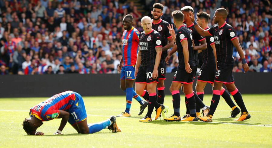 "Football Soccer - Premier League - Crystal Palace vs Huddersfield Town - London, Britain - August 12, 2017 Crystal Palace's Christian Benteke and Wilfried Zaha react after a missed chance as Huddersfield Town players look on REUTERS/Tolga Akmen EDITORIAL USE ONLY.No use with unauthorized audio, video, data, fixture lists, club/league logos or ""live"" services. Online in-match use limited to 45 images, no video emulation.No use in betting, games or single club/league/player publications. Please contact your account representative for further details."