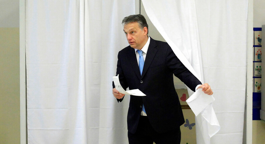 Hungary's Prime Minister Viktor Orban leaves a polling booth to cast his ballot during parliamentary elections in Budapest April 6, 2014. Hungarians vote on Sunday in a parliamentary election set to return Prime Minister Viktor Orban to power for another four years and entrench the far-right Jobbik party as a force in Hungarian politics. REUTERS/Bernadett Szabo (HUNGARY - Tags: POLITICS ELECTIONS)