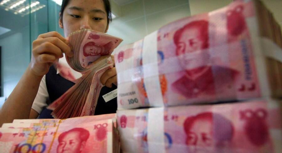 Den kinesiske økonomi er under pres, og renten sænkes for tredje gang på seks måneder.