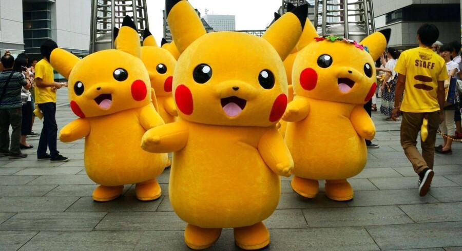 Pikachu er en af de berømte figurer fra Nintendos Pokémon-univers. Nu åbner Nintendo for nye kanaler og er snart klar med et spil til Apples iPad - en utænkelig tanke for et halvt år siden. Arkivfoto: Yoshikazu Tsuno, AFP/Scanpix