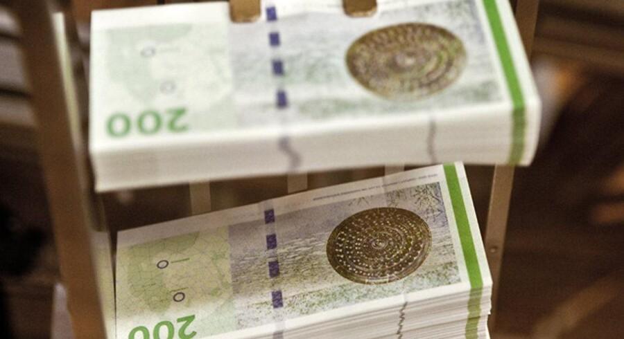 Pengene falder ikke ned i pensionsopsparernes lommer med samme hast som sidste år. Arkivfoto: Scanpix