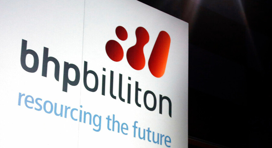 A promotional sign adorns a stage at a BHP Billiton function in central Sydney in this August 20, 2013 file photo. Top global miner BHP Billiton will spin off a roughly $14 billion company to shareholders, mostly offloading assets it acquired in its 2001 merger with Billiton, as it looks to focus on its strongest businesses. Picture taken August 20, 2013.  REUTERS/David Gray/Files  (AUSTRALIA - Tags: BUSINESS COMMODITIES)