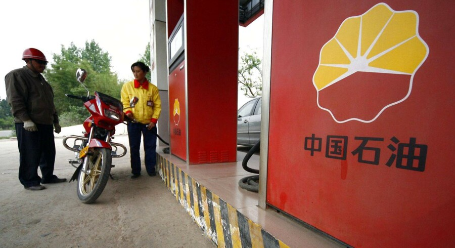 A station attendant fills a motorcycle's petrol tank at a PetroChina gas station in Suining, Sichuan province, in this file picture taken April 27, 2009. PetroChina hopes to produce 1 billion cubic metres of shale gas in 2015 from southwest China's Sichuan basin, a company executive said on September 25, 2011, giving the country its first major commercial production of shale gas. REUTERS/Stringer/Files (CHINA - Tags: ENERGY BUSINESS LOGO) CHINA OUT.NO COMMERCIAL OR EDITORIAL SALES IN CHINA