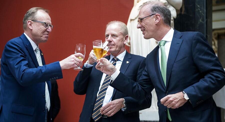 Fra receptionen i Carlsberg, hvor Jørgen Buhl Rasmussen (i midten) stoppede som direktør. Til venstre bestyrelsesformand for Carlsberg Flemming Besenbacher og til højre den nye direktør Cees 't Hart.