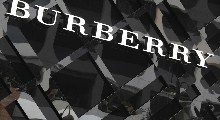 A logo of Burberry is displayed outside its store at Tsim Sha Tsui shopping district in Hong Kong January 18, 2013. China's fashion forward men are snapping up Gucci and Burberry bags, driving a luxury market rebound just months after a Chinese sales slowdown spooked global investors. Picture taken January 18, 2013. REUTERS/Bobby Yip (CHINA - Tags: BUSINESS)