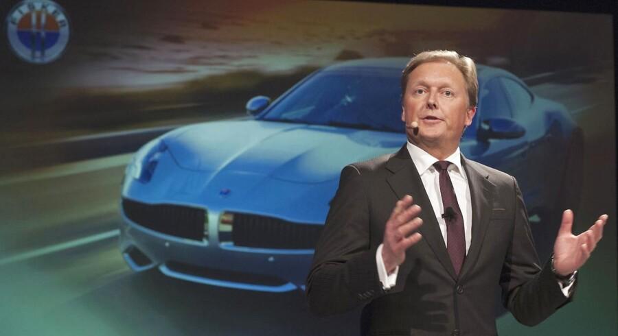 Henrik Fisker var designer for BMW, før han tog til USA og startede sin egen bilvirksomhed. Her ses han foran et billede af hybrid-sportsvognen Fisker Karma.