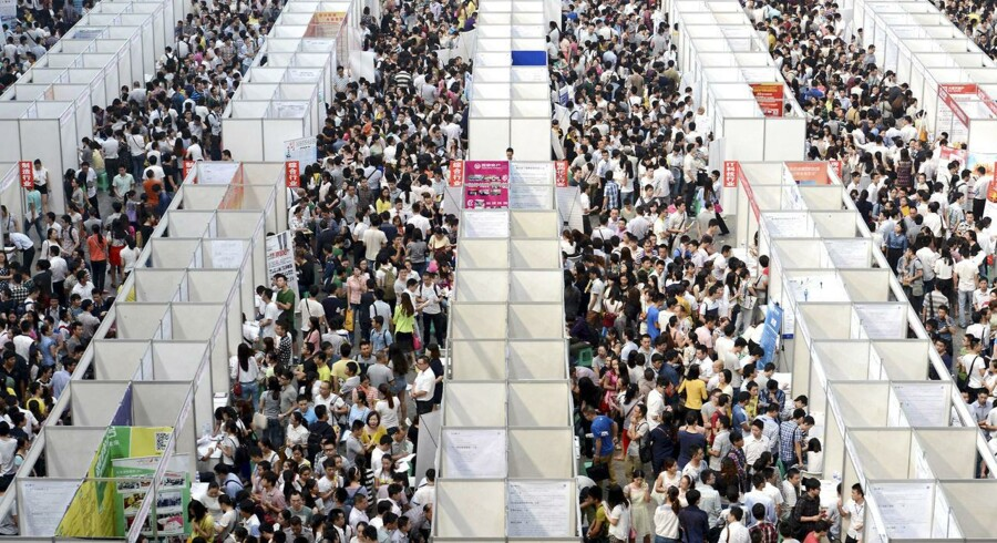 Thousands of job seekers visit booths at a job fair in Chongqing municipality, October 11, 2014.
