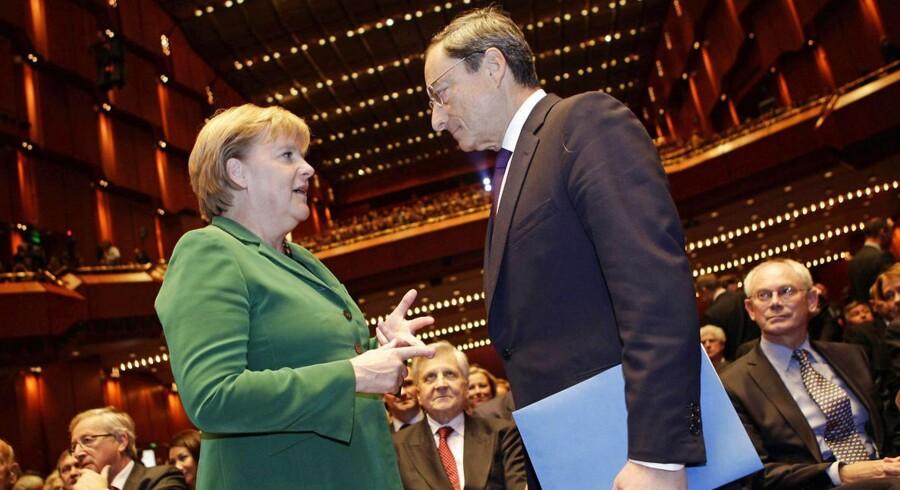 Tysklands kansler Angela Merkel og ECBs Mario Draghi har holdt møde om lempelser.