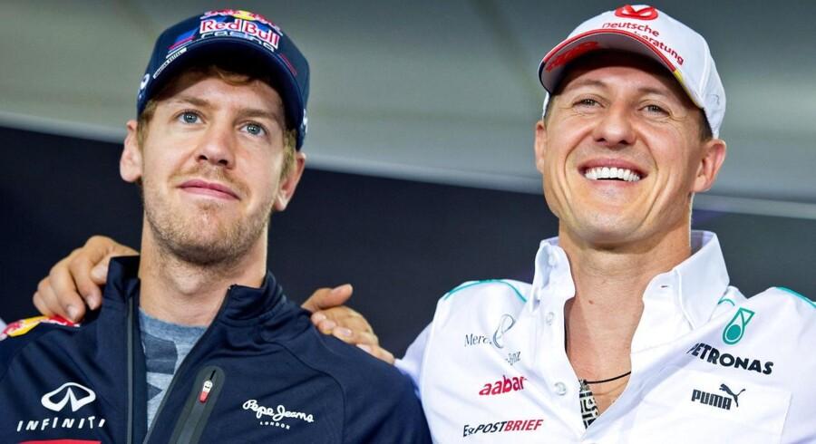 Michael Schumacher (til højre) sammen med Sebastian Vettel i 2012.
