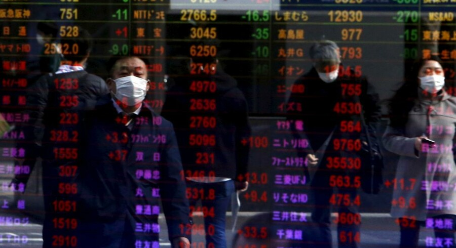 Pedestrians are reflected in an electronic board displaying various stock prices at a brokerage in Tokyo, Japan, February 4, 2016. Asian shares rebounded on Thursday as speculation the U.S. Federal Reserve might opt to not raise interest rates at all this year hammered the dollar and sparked a huge rally in oil prices. REUTERS/Yuya Shino