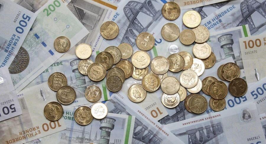 Danske kroner i pengesedler og mønter.