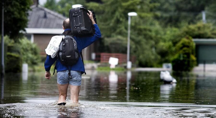 Danmark har undsluppet slemme oversvømmelser, storm og snevejr i 2014. Det milde vejr ventes at give forsikringsselskaberne nogle pæne regnskaber.