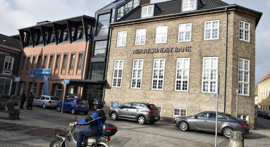 Anders Dam og Karen Frøsig blander sig nu i nordjysk bankkrig.