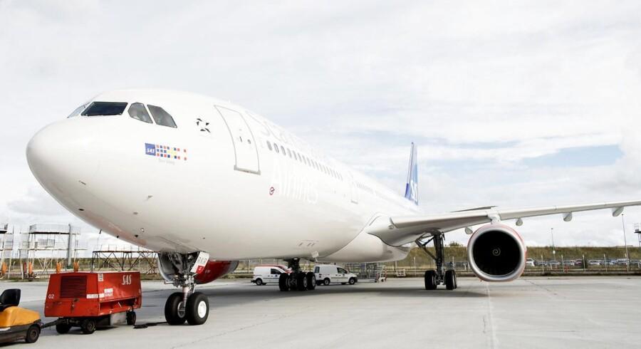Det skandinaviske flyselskab har netop modtaget det første nye langdistancefly i mere end 10 år, og fire mere støder til inden længe. Kom med inden for i det spritnye Airbus A330 Enhanced-fly
