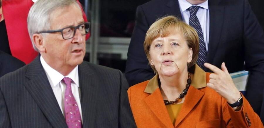 Præsident for EU-Kommissionen, Jean-Claude Juncker, og den tyske kansler, Angela Merkel. EPA/OLIVIER HOSLET
