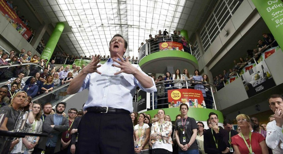 British Prime Minister and leader of the Conservative party David Cameron addresses workers during a UK general election campaign event at ASDA supermarket's headquarters in Leeds, northern England on May 1, 2015. Britain could face days or even weeks of negotiations to form a new government after elections on May 7, with opinion polls suggesting that no one party will win outright. AFP PHOTO / POOL / TOBY MELVILLE