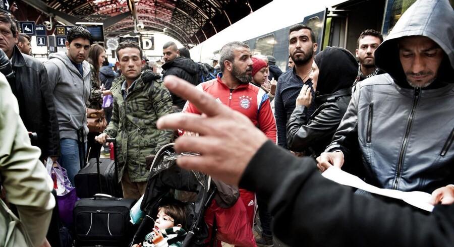 Efter dansk politi torsdag gav flygtninge grønt lys til at rejse frit gennem Danmark uden at lade sig registrere, tog mange toget fra Københavns Hovedbanegård til Sverige.