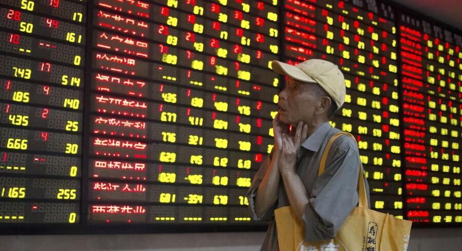 De kinesiske aktier styrtdykkede i dag med det største fald siden før finanskrisen. Foto: REUTERS/China Daily