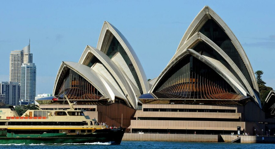 The Manly ferry (below-L) passes by the Sydney Opera House in this photo taken on March 31, 2010. The Sydney Opera House was designed by Danish architect Jorn Utzon and opened in 1973. AFP PHOTO / Greg WOOD