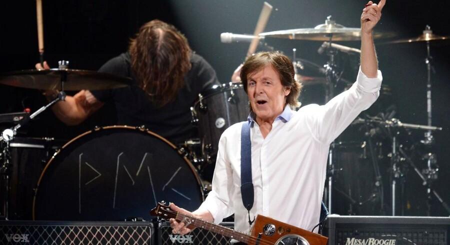 Eks-Beatlen Sir Paul McCartney er blandt hovednavnene på Roskilde Festival 2015. Billedet her er fra en koncert i New York City i 2012.