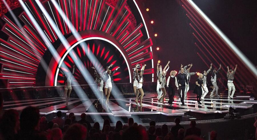 Der var fredag aften generalprøve på det danske Melodi Grand Prix i Forum Horsens. Her ses værterne Annette Heick, Hilda Heick og Jacob Riising på scenen.