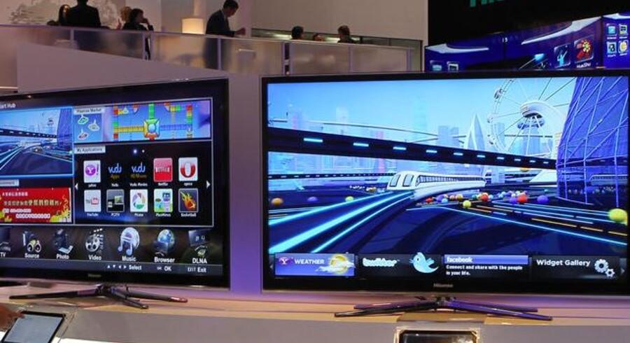 Med digitalt TV i MPEG4-format, som TV-signalerne blev ændret til i januar i år, er der åbnet for flere kanaler på samme plads og flere funktioner på TV-skærmen - men det har været en dyr fornøjelse. Foto: Bruce Bennett, AFP/Scanpix