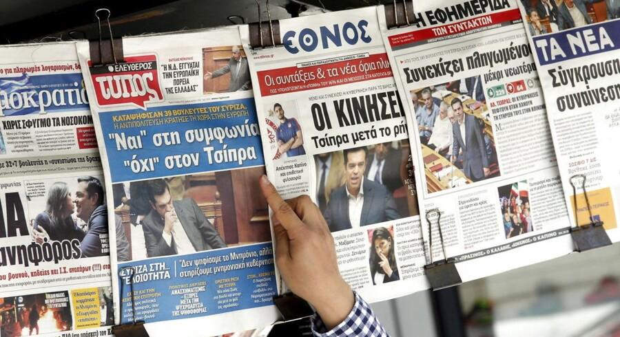 Grækerne vågnede op til forsidenyheden om, at deres parlament i nattens løb havde stemt ja til den første pakke af reformer.