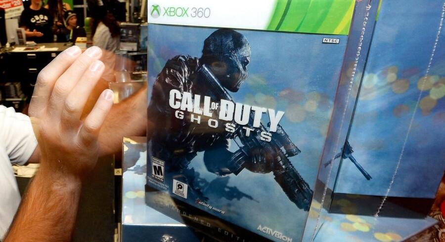 Folk stod i kø foran mange butikker forud for midnatspremieren på det nye »Call of Duty: Ghosts«-spil. Foto: Ethan Miller, Getty/AFP/Scanpix