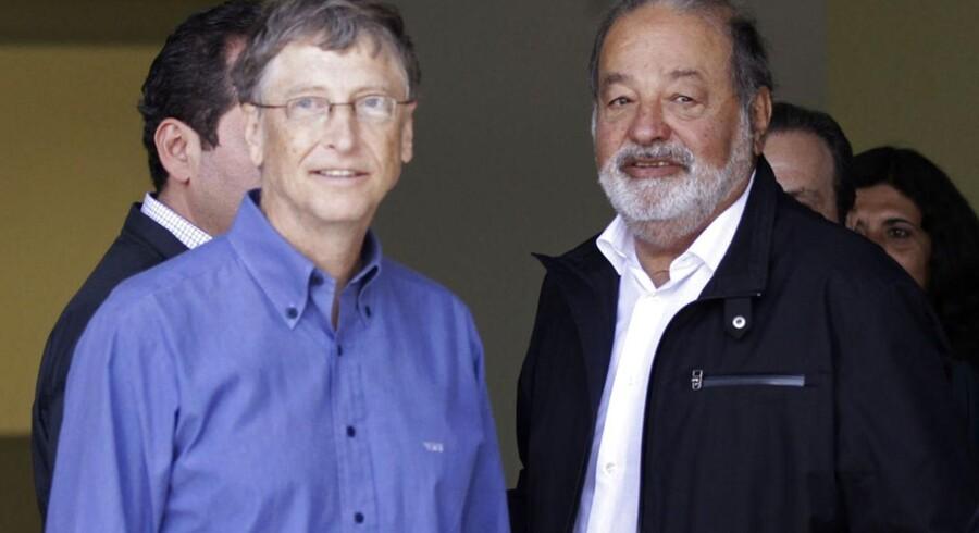 Her er de, verdens to rigeste: Microsoft-stifter Bill Gates (til venstre) og mobilmilliardæren Carlos Slim (til højre). De mødtes i februar i Texcoco uden for Mexico City. Arkivfoto: Henry Romero, Reuters/Scanpix