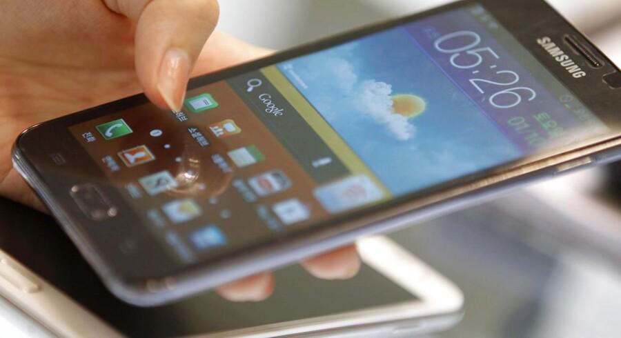 Næsten tre af fire solgte smartphonetelefoner leveres i dag med styresystemet Android. Samsung er den største leverandør. Arkivfoto: Lee Jae-Won, Reuters/Scanpix