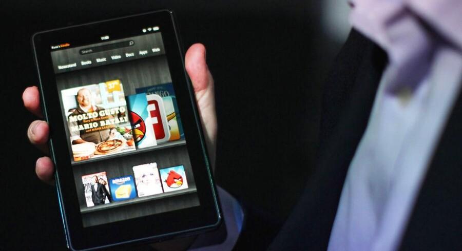 Fremkomsten af de populære tavlecomputere - her Amazons Kindle Fire - har gjort det endnu lettere at se film online via internetforbindelsen. Arkivfoto: Spencer Platt, AFP/Scanpix