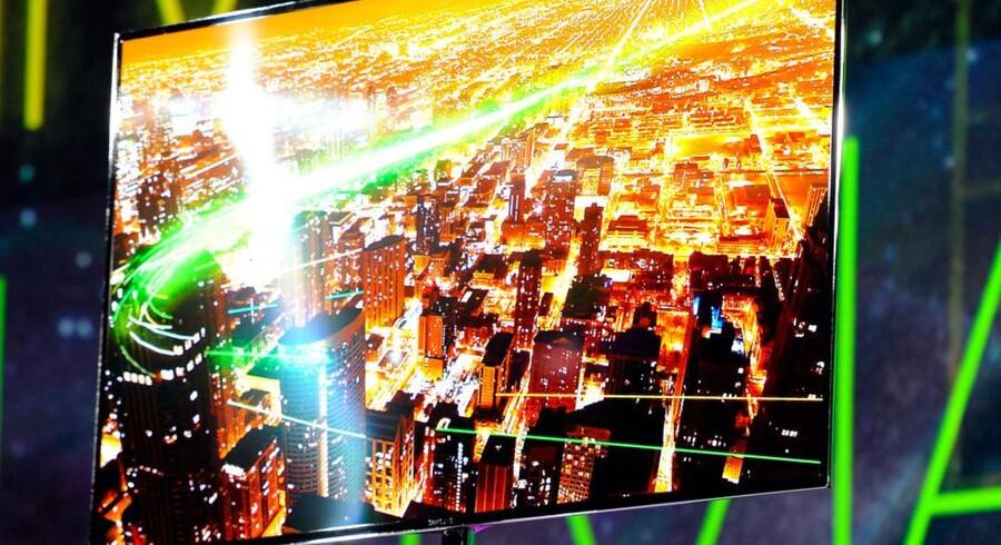 Helt så store fjernsyn som Samsungs nye 55-tommer-TV er ikke gængse i danske hjem, men fjernsynet er blevet det helt centrale - og står for størstedelen af omsætningen i Danmark inden for elektronik. Foto: Ethan Miller, AFP/Scanpix