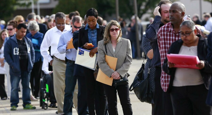 People wait in line to enter the Nassau County Mega Job Fair in Uniondale, New York, in this file photo taken October 7, 2014.